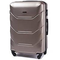 Малый пластиковый чемодан Wings 147 на 4 колесах золотистый