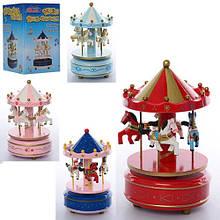 KMMD1120 Деревянная игрушка Карусель MD 1120  18см, заводная, муз, 4цвета, в кор-ке,11,5-11,5-18см