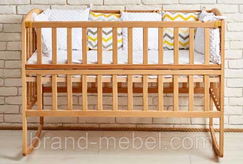 Дерев'яне ліжечко AMELI з відкидною боковиною з дугами на коліщатках