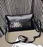 Женская сумочка-клатч черная из экокожи с металлическим декором