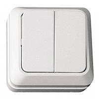 Вимикач двухклавішний накл. керам. Opera біла 2003 (LUXEL) (уп.10 шт.)