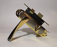 Ручка с механизмом под фиксатор Браво 62мм сатен-золото