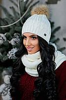 Красивая женская шапочка с помпоном из енота
