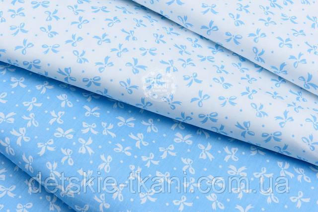 Сатин  с точками и бантиками голубыми на белом