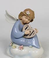 Фарфоровая музыкальная фигурка Ангелочек (Pavone)