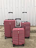 Большой пластиковый чемодан Ormi 8009 на 4 колесах бордовый, фото 1