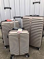 Большой пластиковый чемодан Ormi 8009 на 4 колесах золотистый
