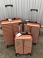 Большой пластиковый чемодан Ormi 8009 на 4 колесах оранжевый