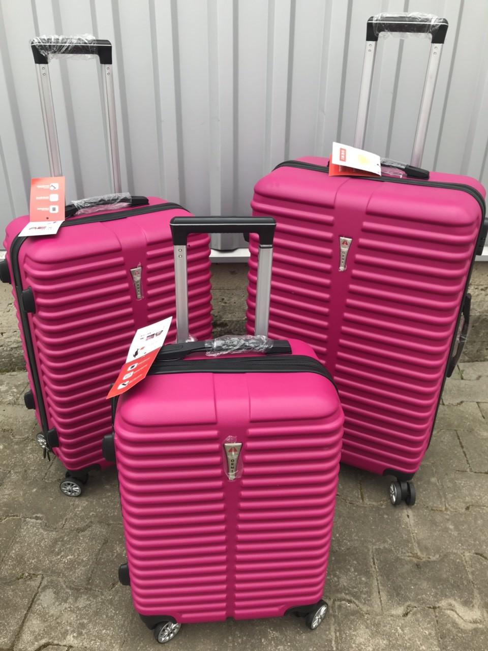 Большой пластиковый чемодан Ormi 8009 на 4 колесах розовый