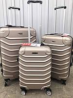 Большой пластиковый чемодан Ormi 2065 на 4 колесах золотистый, фото 1