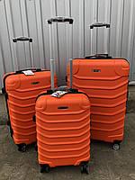 Большой пластиковый чемодан Ormi 2065 на 4 колесах оранжевый, фото 1