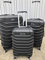 Большой пластиковый чемодан Ormi 2065 на 4 колесах черный, фото 1