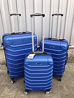 Средний пластиковый чемодан Ormi 2065 на 4 колесах синий