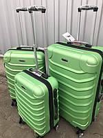 Средний пластиковый чемодан Ormi 2065 на 4 колесах зеленый, фото 1