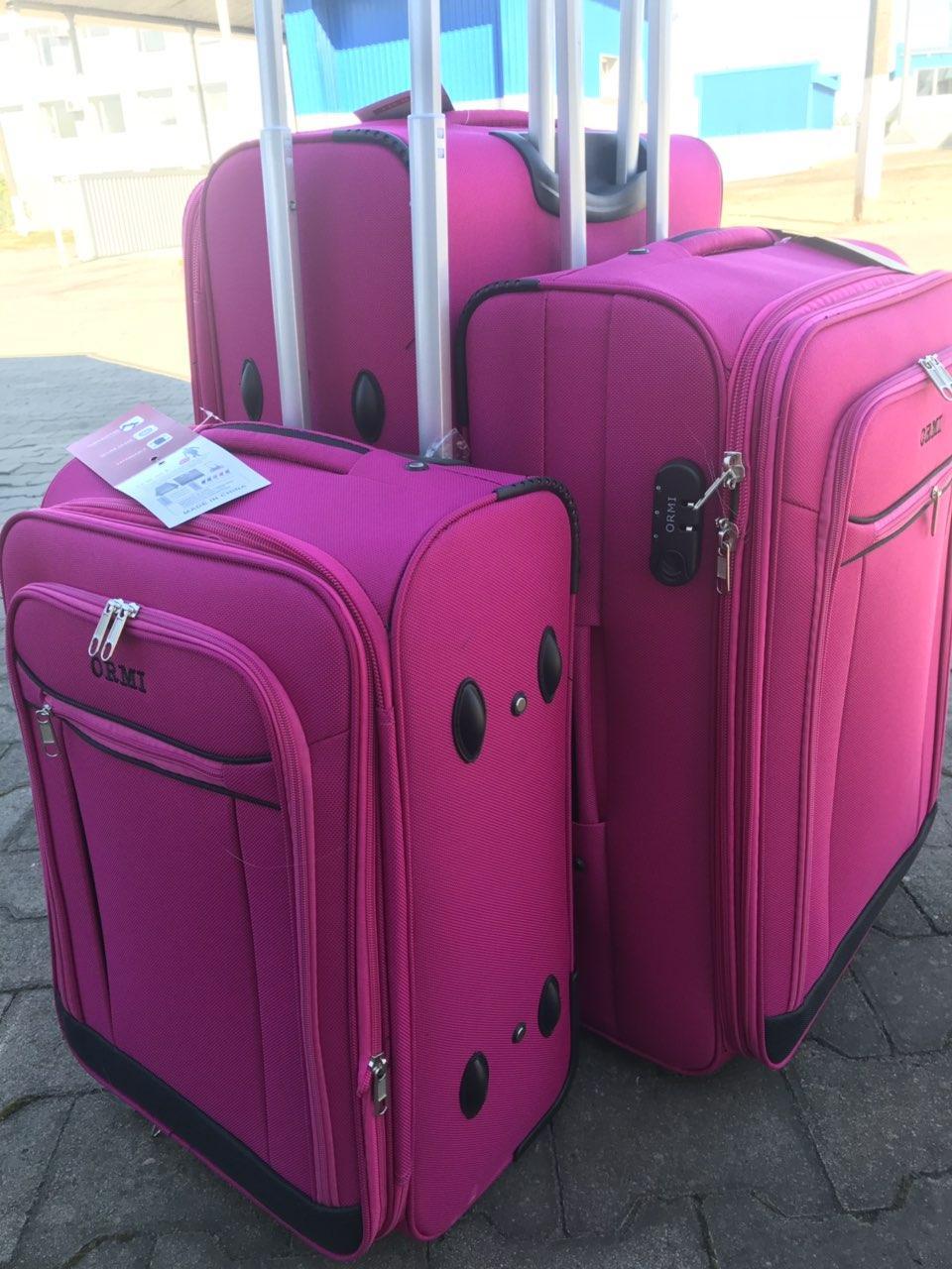 Средний тканевый чемодан Ormi 1318 на 2 колесах розовый
