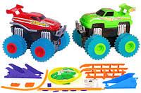 Машинки на бат. Trix Trux вездеходы-трюкачи набор 2 машинки с трассой красный+зеленый