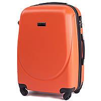 Средний пластиковый чемодан Wings 310 на 4 колесах оранжевый