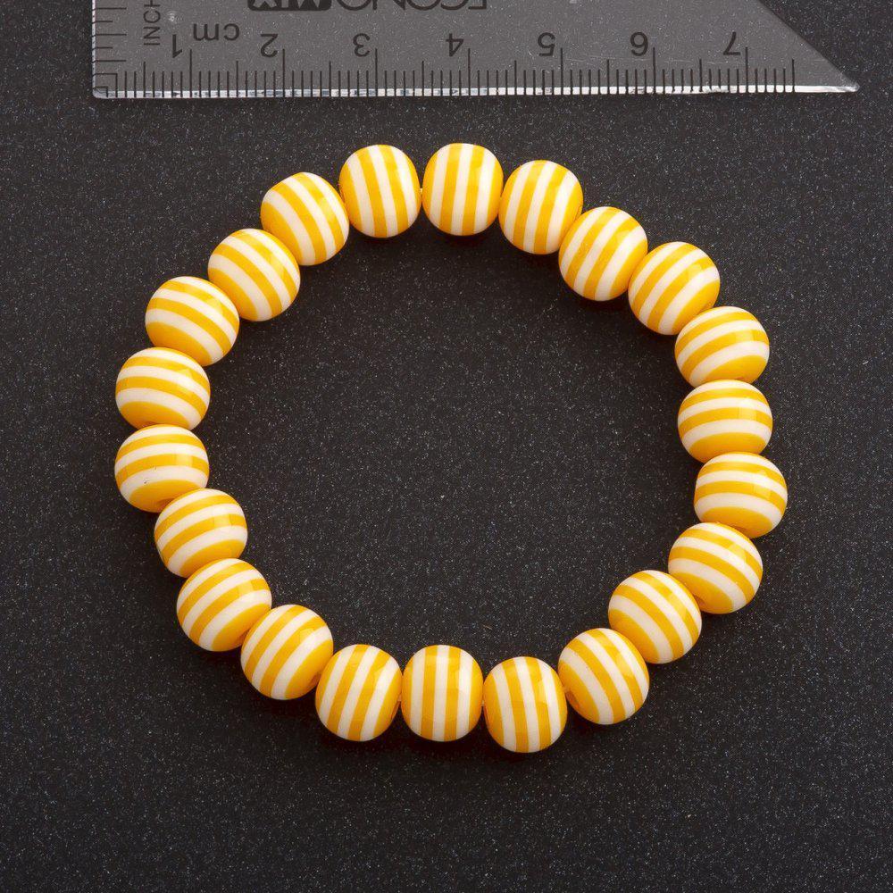 Браслет полосатая бусина на резинке d-10 мм желтый