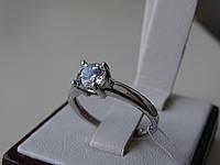 Серебряное родированное кольцо с белым камнем