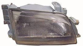 Фара левая Toyota Carina E 92-97 электрокорректор STANLEY/CARELLO стеклянный рассеиватель (DEPO). 212-1156L-LD-EM