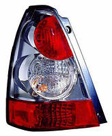 Фонарь левый Subaru Forester 06-08 хромированный (DEPO). 320-1908L-AS1
