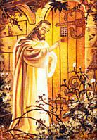 Икона из янтаря в декоративной рамке.