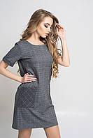 Женское платье прямого кроя с карманами