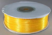 Лента атласная. Цвет - темно-желтый. Ширина - 0,3 см, длина - 123 м