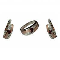 Серебряный набор с золотыми вставками кольцо и серьги с красным камнем в центре 32у