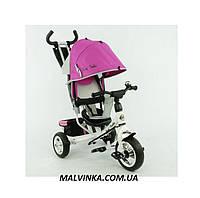 Детский трехколесный велосипед розовый Profi Trike на колесах Eva Foam с капюшоном колясочного типа..