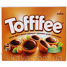 Конфеты Toffifee с лесным орехом в мягкой карамели с нугой Storck  , 125  гр