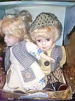 Фарфоровые коллекционные куклы набор мальчик и девочка сидячие,20см
