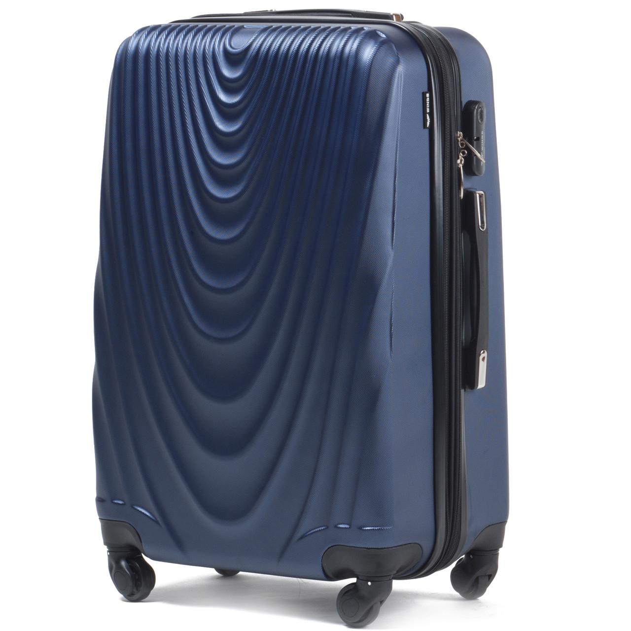 Средний пластиковый чемодан Wings 304 на 4 колесах синий