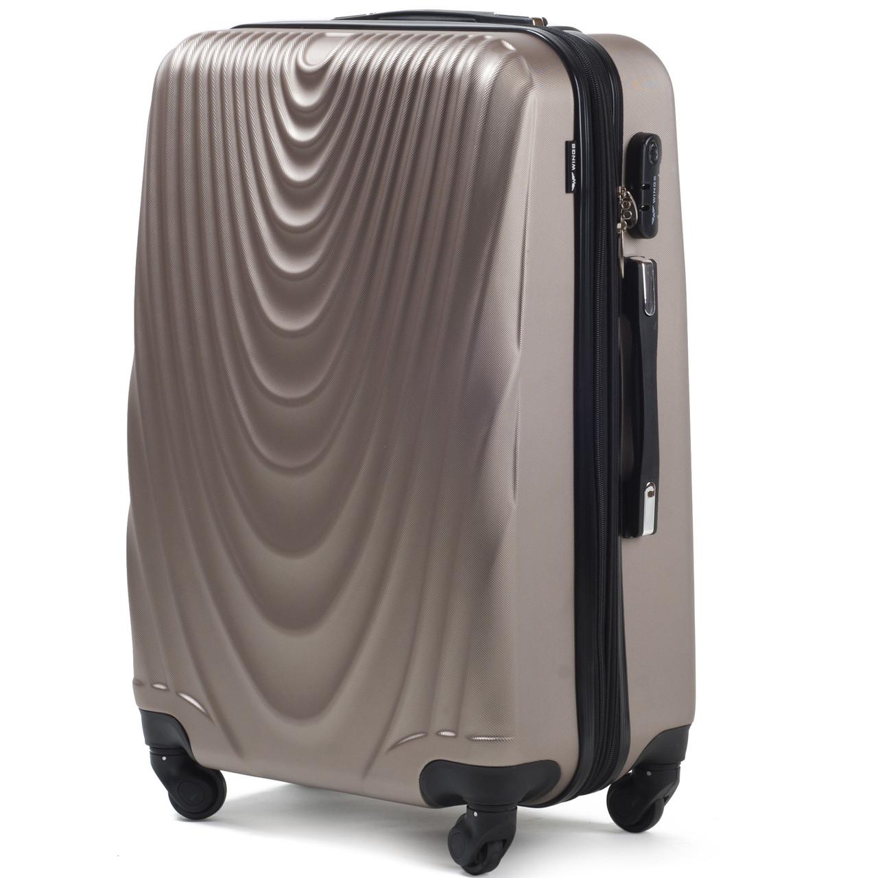 Средний пластиковый чемодан Wings 304 на 4 колесах золотистый