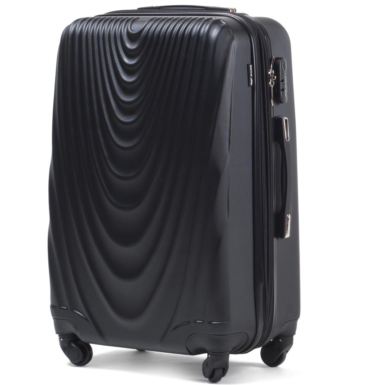 Малый пластиковый чемодан Wings 304 на 4 колесах черный