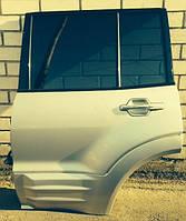 Дверь задняя левая под накладку голая Mitsubishi Pajero III 02-07г MN150367