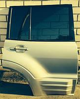 Дверь задняя правая под накладку голая Mitsubishi Pajero III 00-07г MN150368