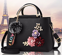 84380abb Красивая черная женская сумка в форме чемоданчика с меховым брелком ...