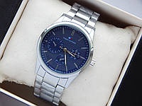 Наручные часы Tommy Hilfiger серебристого цвета с синим циферблатом