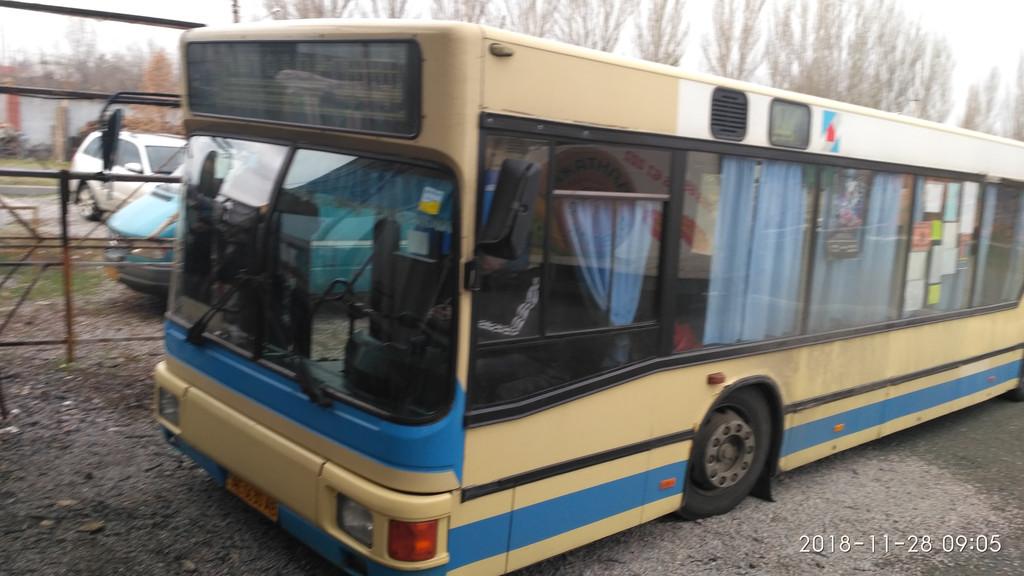 Производств и замена лобового стекла триплекс на автобусе MAN NL 202  в Никополе (Украина). 62