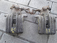 Суппорт тормозной задний левый VW passat b5