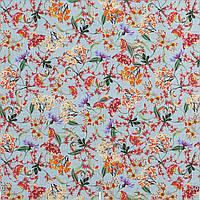 Декоративные ткани с цветными веточками растений на голубом фоне