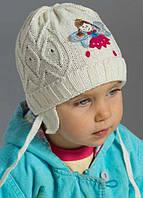Детская вязанная весенняя шапка