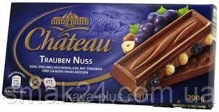 Шоколад молочный  с цельным лесным орехом и изюмом Feinherb Nuss Chateau Германия 200г