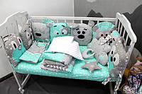 Бортики в кроватку и постельные комплекты для новороженных