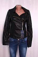 Жіноча куртка з шкір-заступника