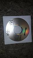 Диск и наклейка Microsoft Works 8