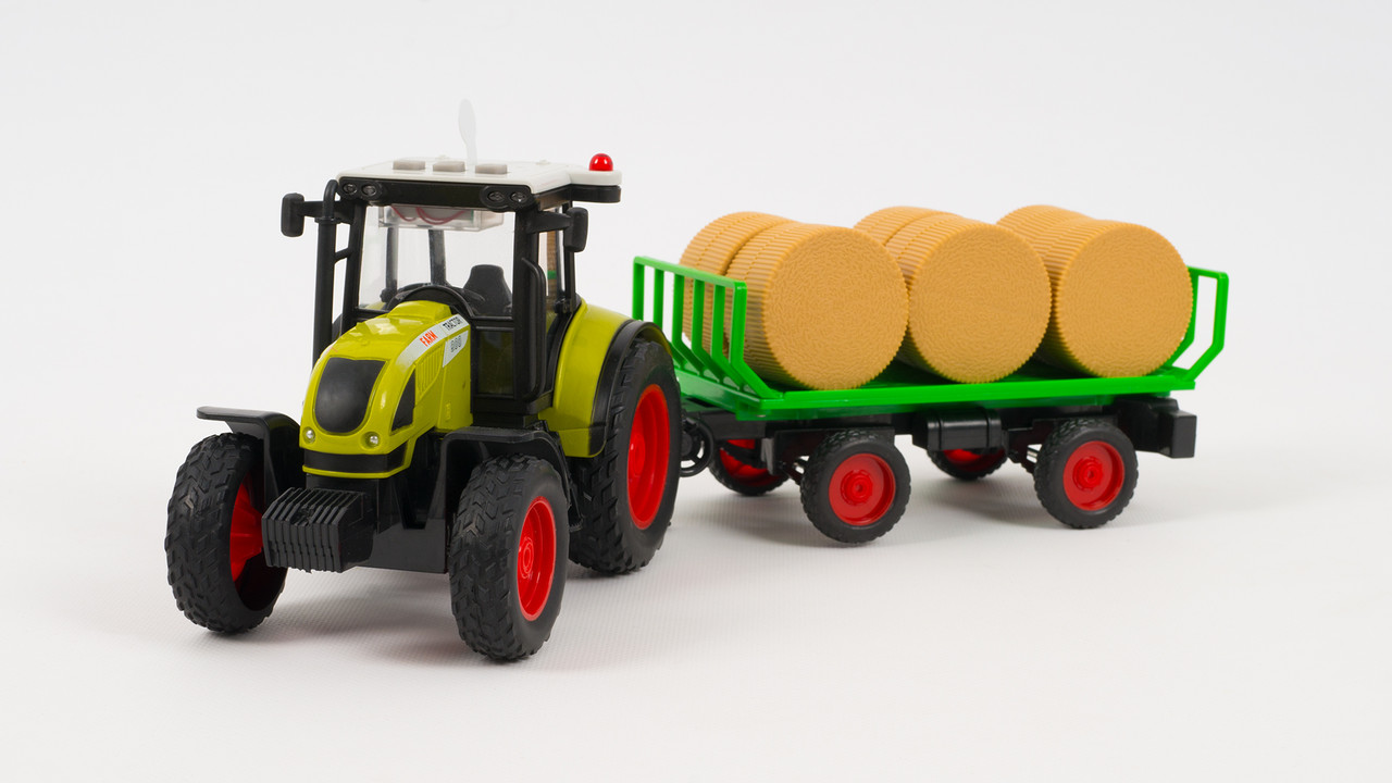 Трактор с прицепом. Двигается по инерции. Со световыми и звуковыми эффектами