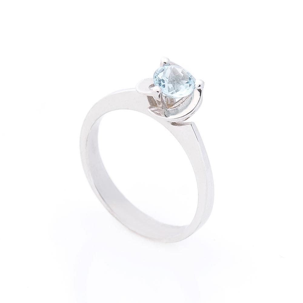 Золотое помолвочное кольцо с голубым топазом гк02602