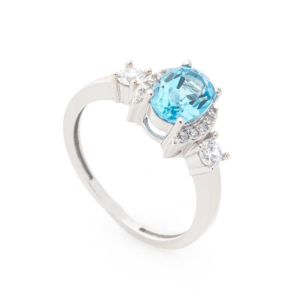 Золотое кольцо с голубым топазом и фианитами гк04641
